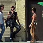 Danny (Val Kilmer) and Jimmy the Fin (Peter Sarsgaard) emerge from the party house in search of more drugs.