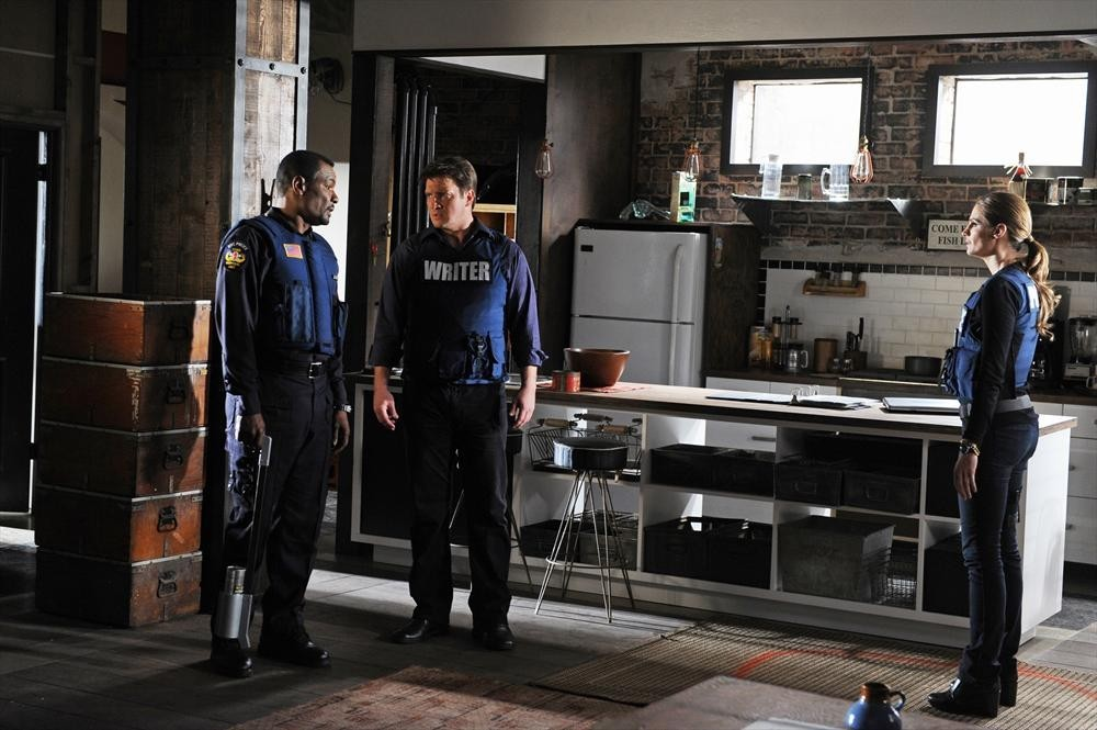 Nathan Fillion, Allan Louis, and Stana Katic in Castle (2009)