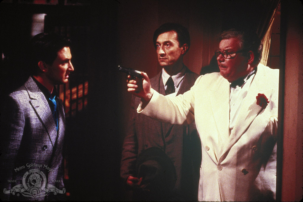 Sean Penn, Richard Griffiths, and Philip Sayer in Shanghai Surprise (1986)