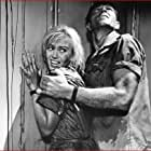 Kieron Moore and Janette Scott in Crack in the World (1965)