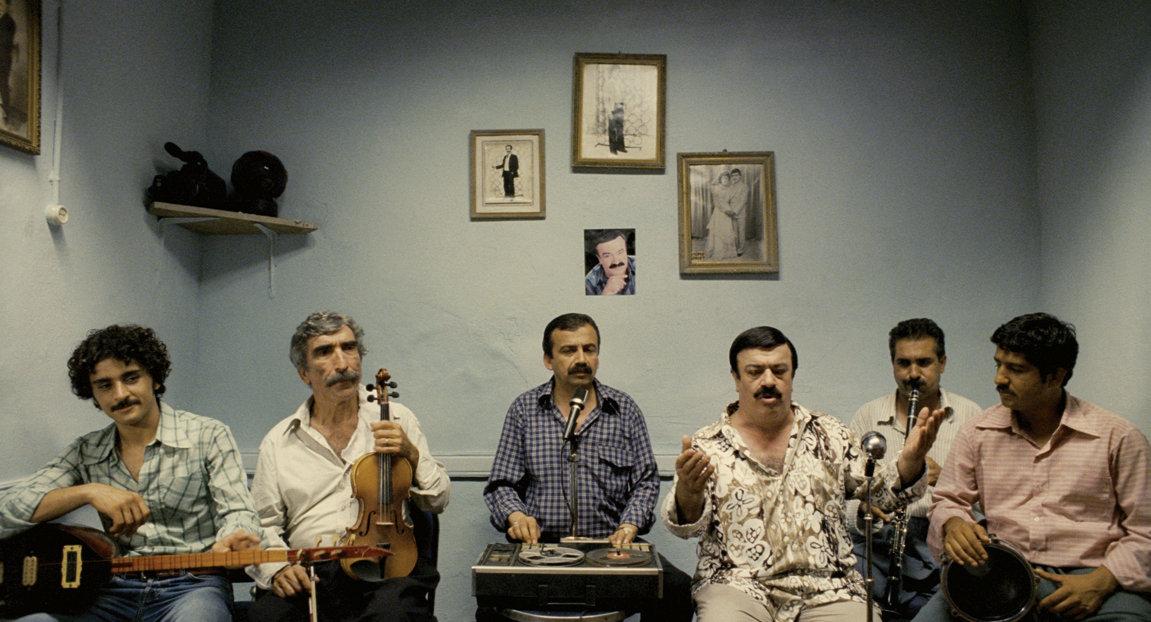 Cezmi Baskin, Sirri Süreyya Önder, and Umut Kurt in Beynelmilel (2006)