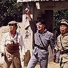 Jacky Cheung and Wu Ma in Zhong yi qun ying (1989)