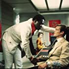 Roger Moore, Yaphet Kotto, Jane Seymour, and Julius Harris in Live and Let Die (1973)