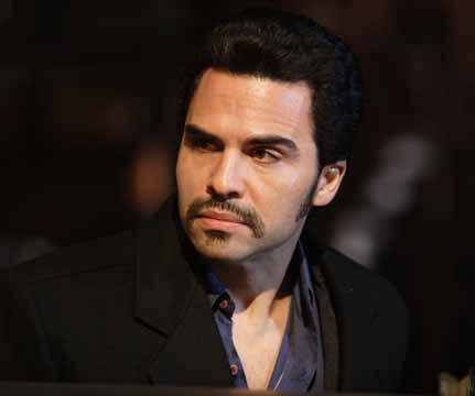 Manny as Eddie from El Cantante