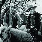 John Wayne and Frank Puglia in Tall in the Saddle (1944)