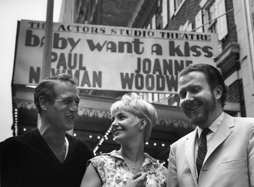 """Paul Newman, Joanne Woodward and James Costigan in front of the marquee for """"Baby Want a Kiss"""""""
