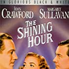 Joan Crawford, Robert Young, and Melvyn Douglas in The Shining Hour (1938)