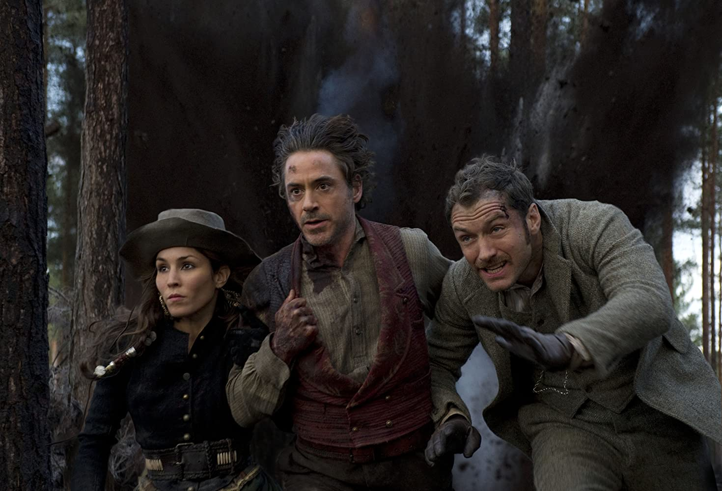 Jude Law, Robert Downey Jr., and Noomi Rapace in Sherlock Holmes: A Game of Shadows (2011)