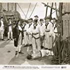 Terry Kilburn, Ron Randell, and Rhys Williams in Tyrant of the Sea (1950)