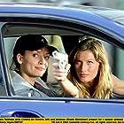 Ana Cristina de Oliveira and Gisele Bündchen in Taxi (2004)