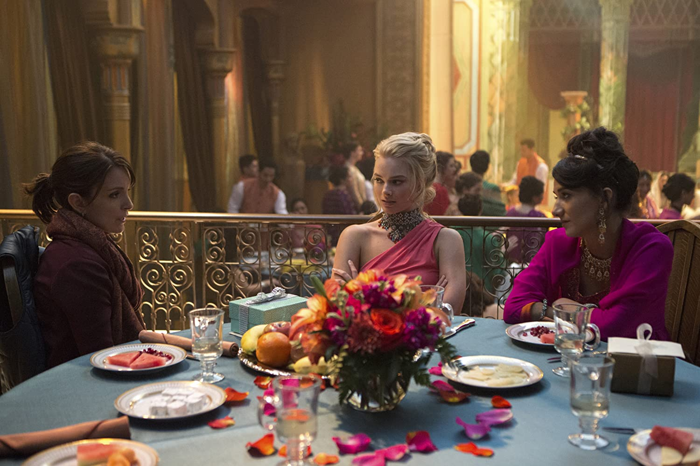 Tina Fey, Sheila Vand, and Margot Robbie in Whiskey Tango Foxtrot (2016)