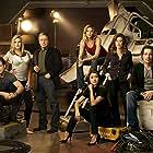 Mary McDonnell, Edward James Olmos, Jamie Bamber, James Callis, Grace Park, Katee Sackhoff, and Tricia Helfer in Battlestar Galactica (2004)