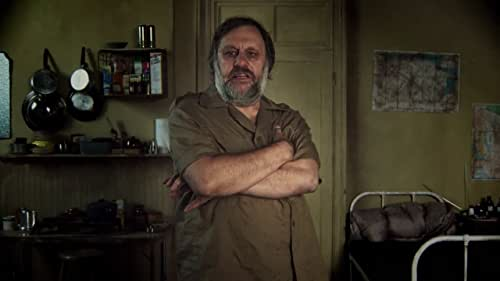 """Cultural theorist superstar Slavoj Žižek re-teams with director Sophie Fiennes (The Pervert's Guide to Cinema) for another wildly entertaining romp through the crossroads of cinema and philosophy. With infectious zeal and a voracious appetite for popular culture, Žižek literally goes inside some truly epochal movies, all the better to explore and expose how they reinforce prevailing ideologies. As the ideology that undergirds our cinematic fantasies is revealed, striking associations emerge: What hidden Catholic teachings lurk at the heart of The Sound of Music? What are the fascist political dimensions of Jaws? Taxi Driver, Zabriskie Point, The Searchers, The Dark Knight, John Carpenter's They Live (""""one of the forgotten masterpieces of the Hollywood Left""""), Titanic, Kinder Eggs, verité news footage, Beethoven's """"Ode to Joy"""" and propaganda epics from Nazi Germany and Soviet Russia all inform Žižek's stimulating, provocative and often hilarious psychoanalytic-cinematic rant."""