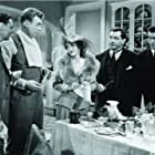 Bette Davis, John Alexander, Jerome Cowan, and Peter Whitney in Mr. Skeffington (1944)