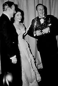 """""""Academy Awards: 25th Annual,"""" Elizabeth Taylor with husband Michael Wild & Walt Disney.  1953."""