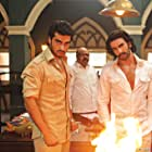 Saurabh Shukla, Arjun Kapoor, and Ranveer Singh in Gunday (2014)