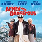 Meg Ryan, John Candy, and Eugene Levy in Armed and Dangerous (1986)