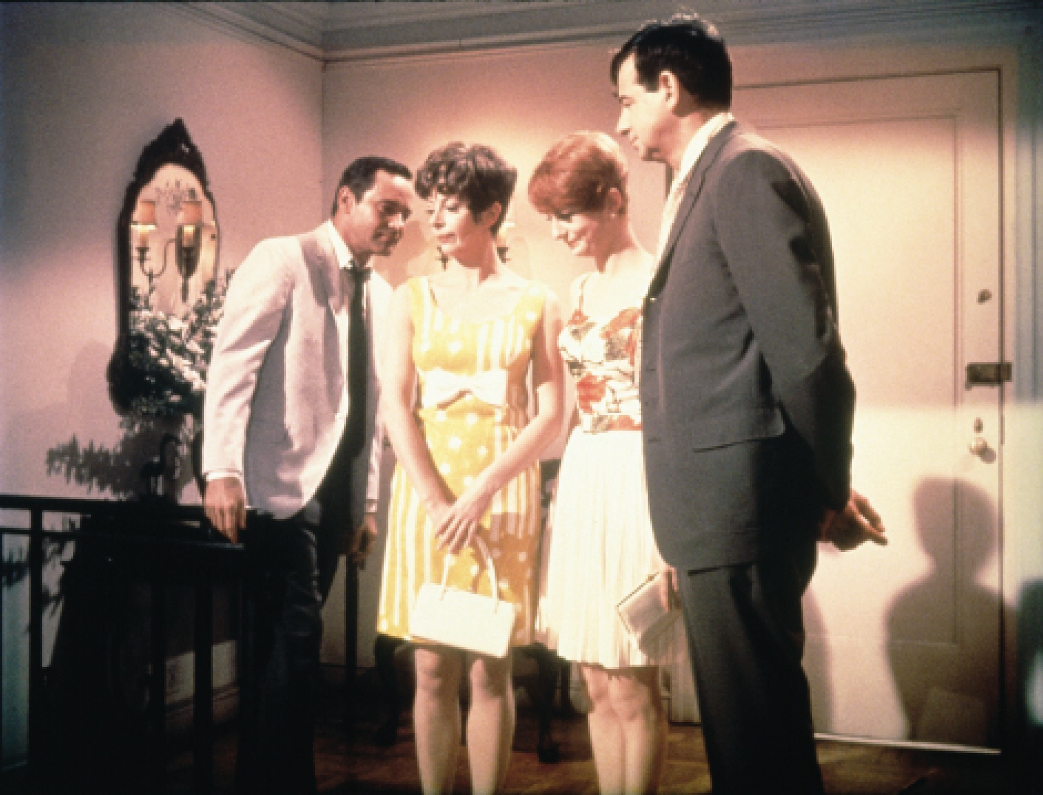 Jack Lemmon, Walter Matthau, Monica Evans, and Carole Shelley in The Odd Couple (1968)
