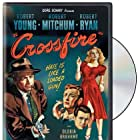 Robert Mitchum, Robert Young, Gloria Grahame, and Robert Ryan in Crossfire (1947)