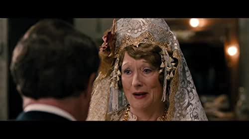 """Set in 1940s New York, Florence Foster Jenkins is the true story of the legendary New York heiress and socialite (Meryl Streep) who obsessively pursued her dream of becoming a great singer. The voice she heard in her head was beautiful, but to everyone else it was hilariously awful. Her """"husband"""" and manager, St. Clair Bayfield (Hugh Grant), an aristocratic English actor, was determined to protect his beloved Florence from the truth. But when Florence decided to give a public concert at Carnegie Hall, St. Clair knew he faced his greatest challenge."""