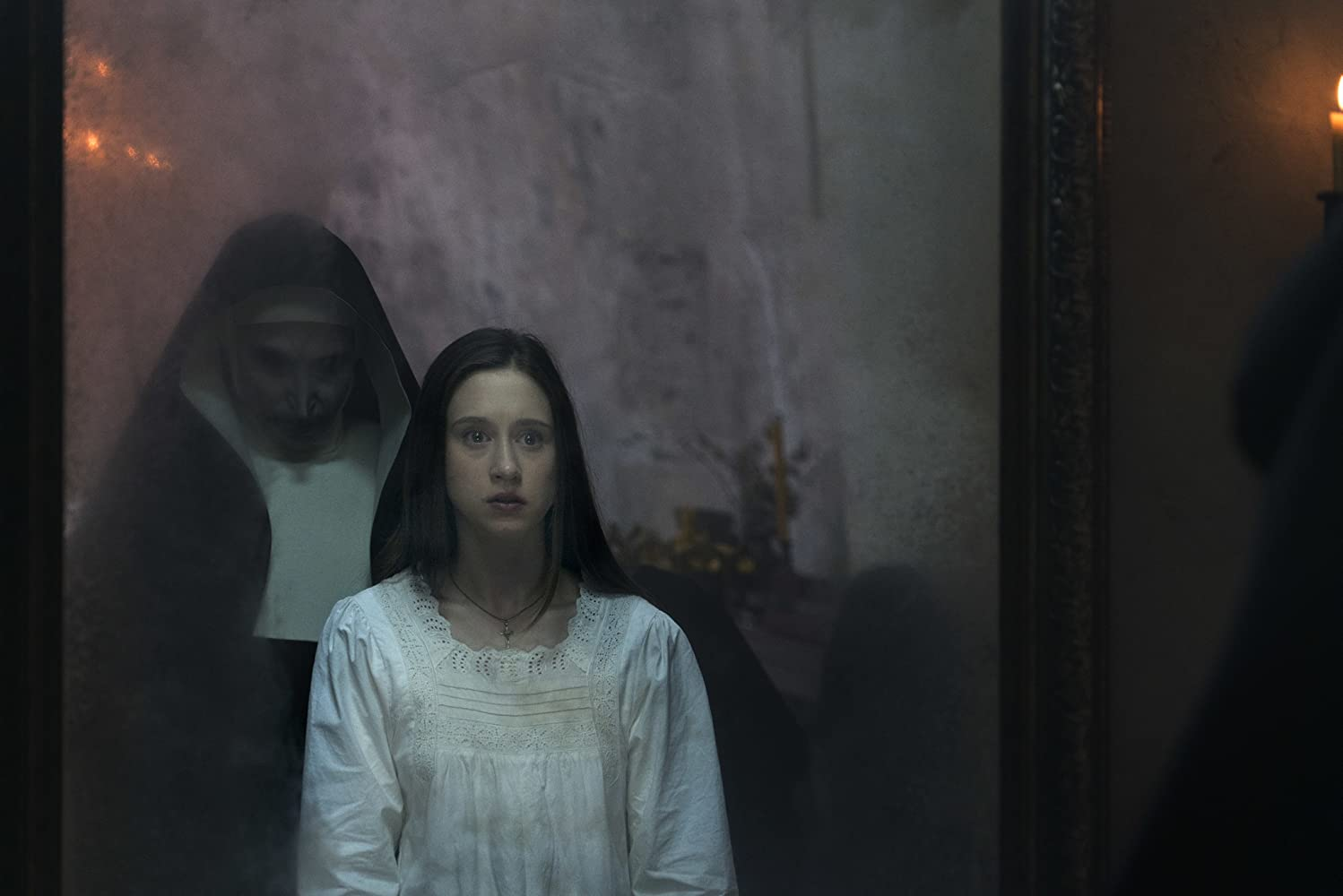 Bonnie Aarons and Taissa Farmiga in The Nun (2018)