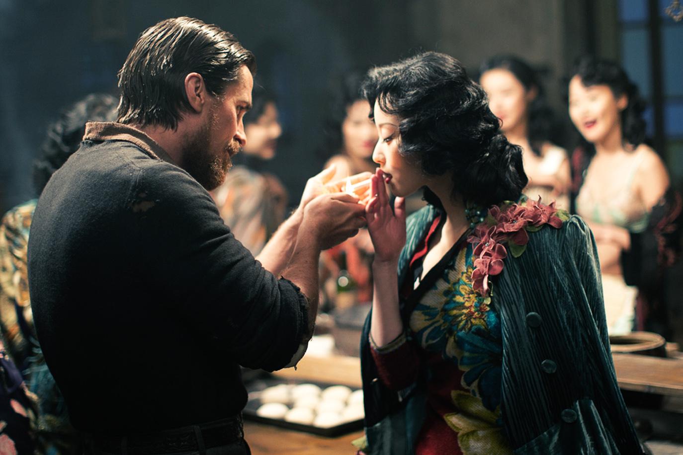 Christian Bale and Ni Ni in Jin ling shi san chai (2011)