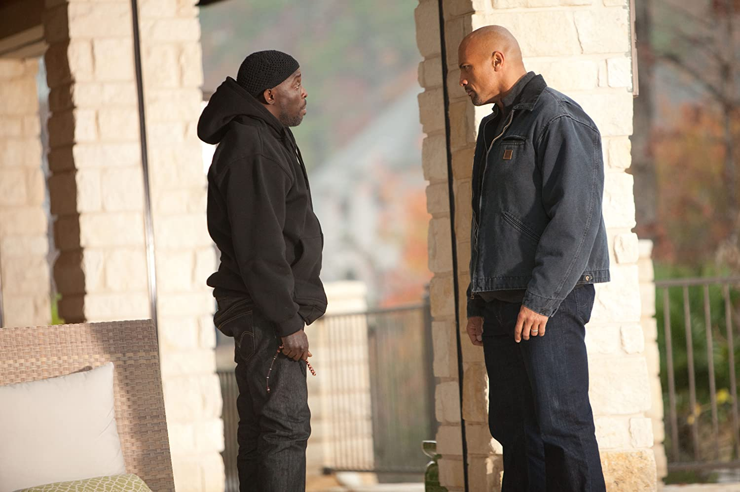 Dwayne Johnson and Michael Kenneth Williams in Snitch (2013)