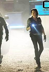 George Eads and Jorja Fox in CSI: Crime Scene Investigation (2000)