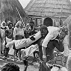 Michael Douglas, Kathleen Turner, and Hyacinthe N'Iaye in The Jewel of the Nile (1985)