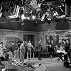 """James Stewart, Alfred Hitchcock, and Cast on the set of """"Rope."""" 1948 Warner"""