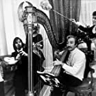 """""""Magic Christian, The"""" Ringo Starr plays the flute while Peter Sellar dabbles with the harp. 1969 Commonwealth United / MPTV"""
