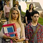 Dianna Agron and John D'Leo in The Family (2013)