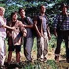 Téa Leoni, William H. Macy, Sam Neill, Alessandro Nivola, and Trevor Morgan in Jurassic Park III (2001)