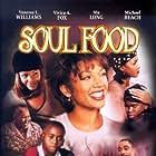 Vivica A. Fox, Nia Long, Vanessa Williams, Michael Beach, Irma P. Hall, Brandon Hammond, and Jeffrey D. Sams in Soul Food (1997)