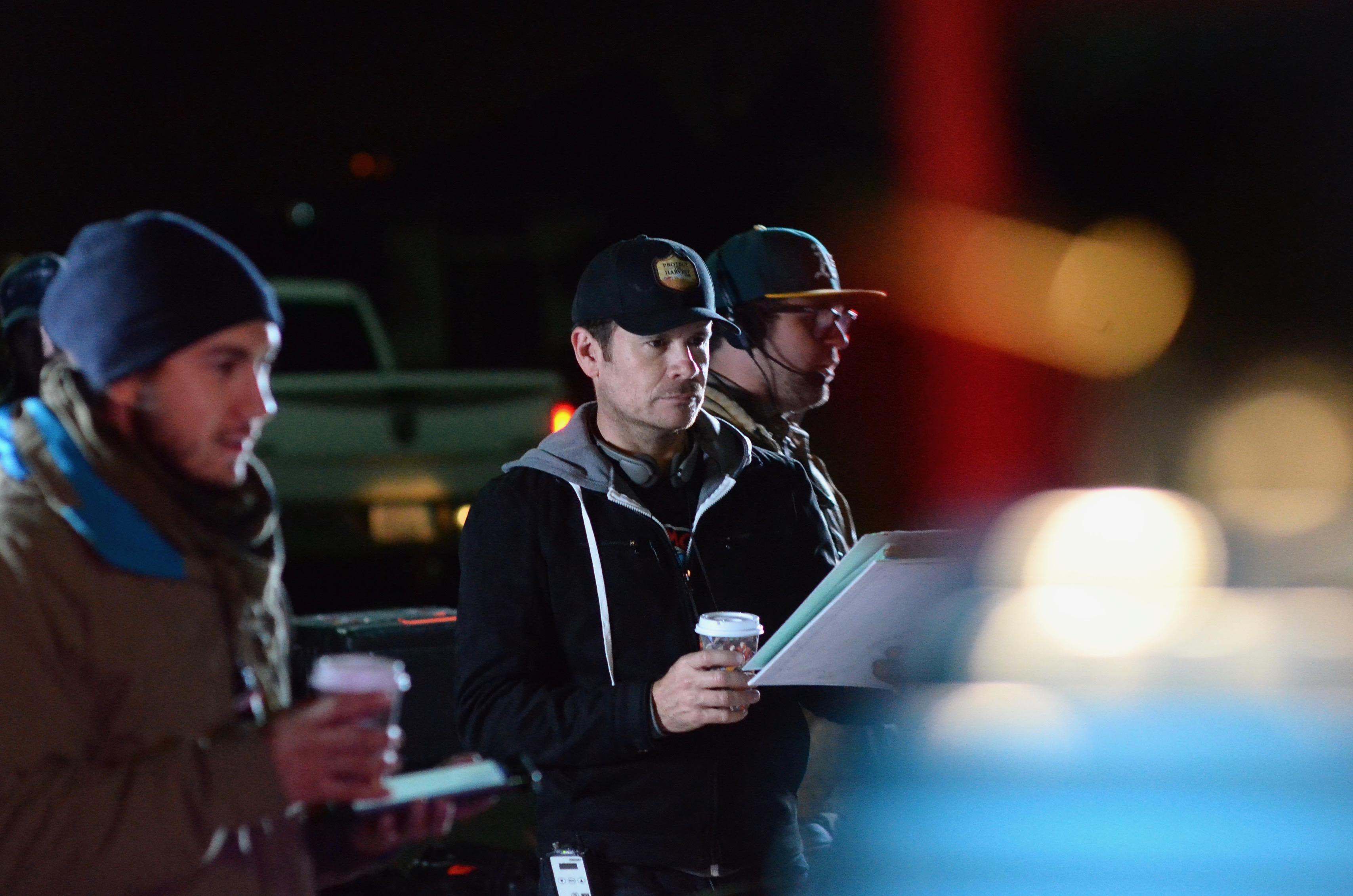 Director Alex Ranarivelo on the set of Dirt.