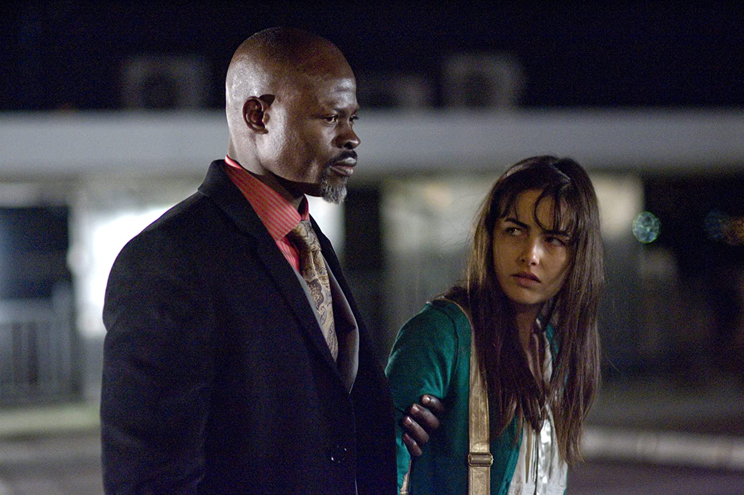 Camilla Belle and Djimon Hounsou in Push (2009)
