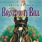 Myrna Loy, Warner Baxter, and Broadway Bill in Broadway Bill (1934)