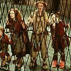 The Clock family - Peagreen (Tom Felton), Homilly (Celia Imrie), Pod (Jim Broadbent) and Arrietty (Flora Newbigin) behind bars.