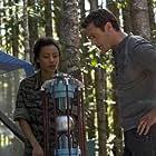 Jason O'Mara and Emilia Burns in Terra Nova (2011)