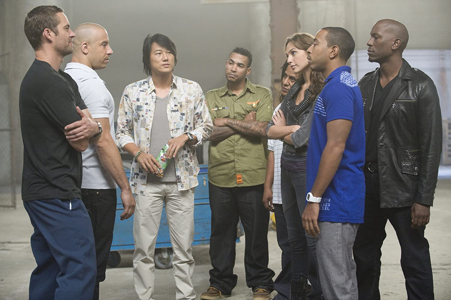 Vin Diesel, Sung Kang, Ludacris, Tyrese Gibson, Paul Walker, Tego Calderon, Don Omar, and Gal Gadot in Fast Five (2011)