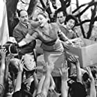 Adored by the people of Argentina, Eva Peron (Madonna, center) uses her position as First Lady to help the masses.