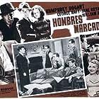 Humphrey Bogart, William Holden, Jane Bryan, Joe Devlin, Paul Kelly, Marc Lawrence, Lee Patrick, and George Raft in Invisible Stripes (1939)