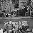 Roy Clark, Grandpa Jones, Stringbean, and Lisa Todd in Hee Haw (1969)