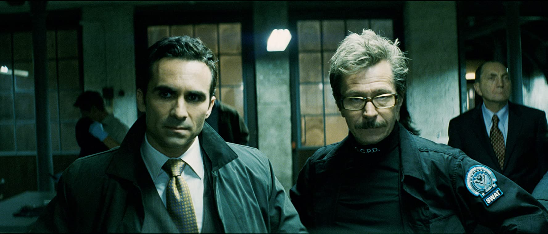 Gary Oldman and Nestor Carbonell in The Dark Knight (2008)