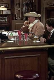 Kirstie Alley, John Ratzenberger, and George Wendt in Cheers (1982)