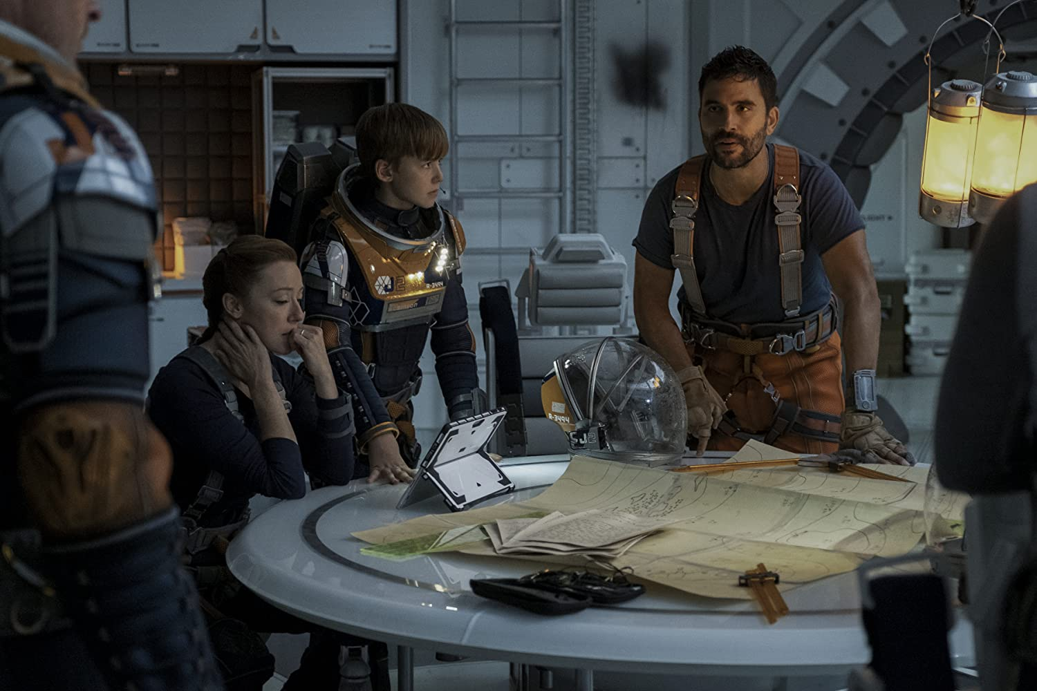 Molly Parker, Toby Stephens, Ignacio Serricchio, and Maxwell Jenkins in Lost in Space (2018)