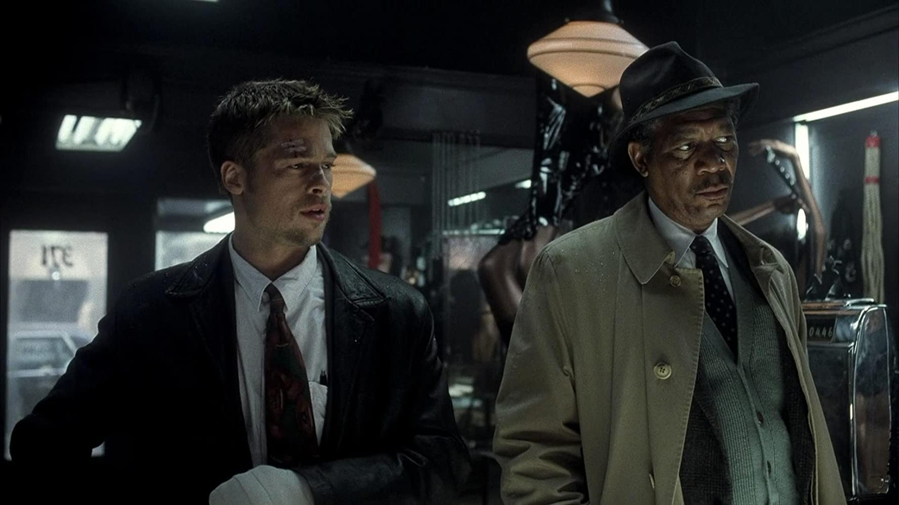 Brad Pitt and Morgan Freeman in Se7en (1995)