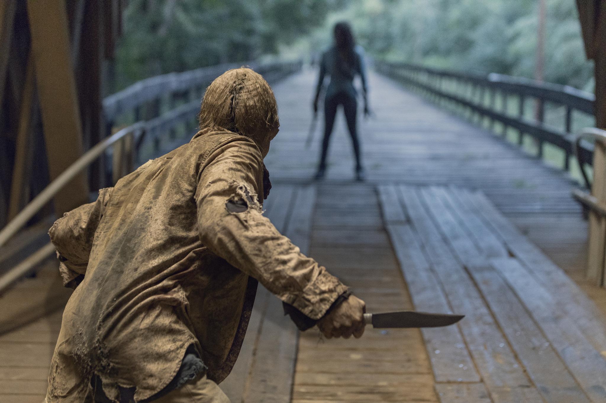 Danai Gurira and David L. Marston in The Walking Dead (2010)
