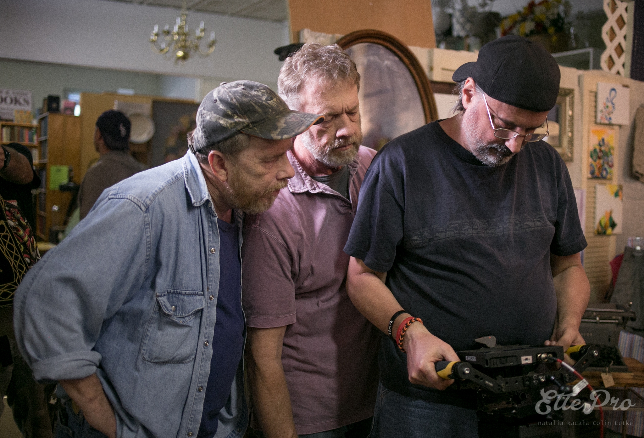 L to R: Tommy G. Kendrick, Keith Rushing, Andrew Librizzi watch replay on set of Somewhere Between Heaven and Hell