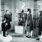 Ginger Rogers, Cecil Cunningham, Kay Linaker, and Richard Nichols in Kitty Foyle (1940)